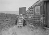 SD941834A, Man marking Ordnance Survey minor control revision point with an arrow in 1950s