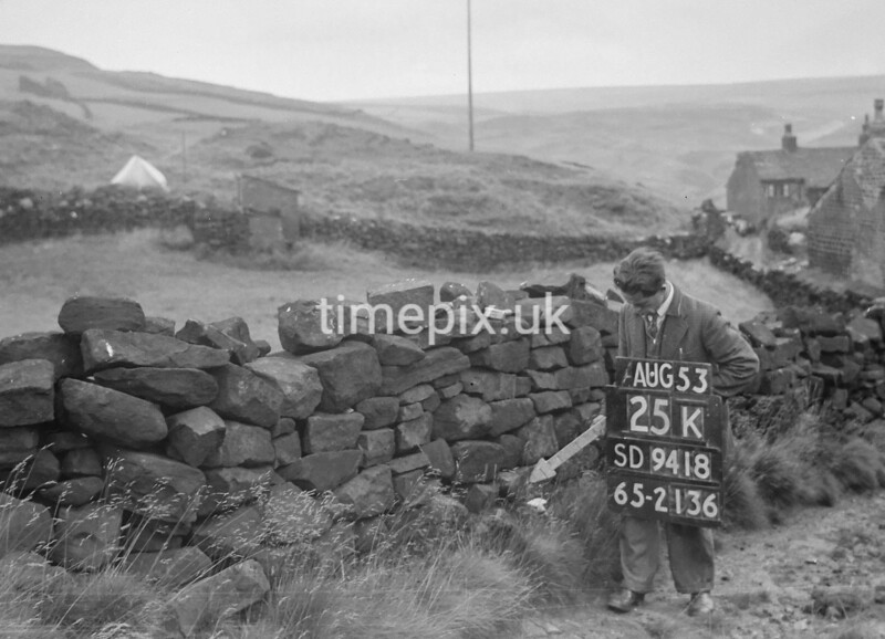 SD941825K, Man marking Ordnance Survey minor control revision point with an arrow in 1950s