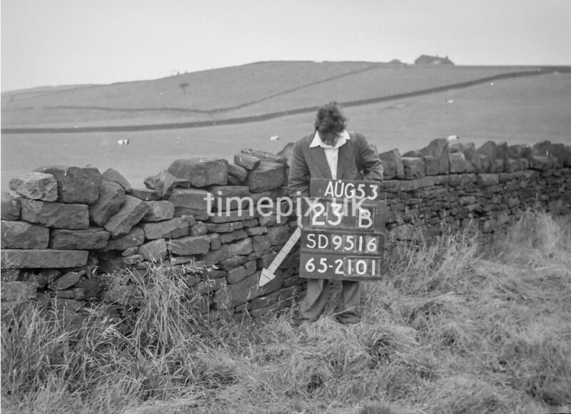 SD951623B, Man marking Ordnance Survey minor control revision point with an arrow in 1950s