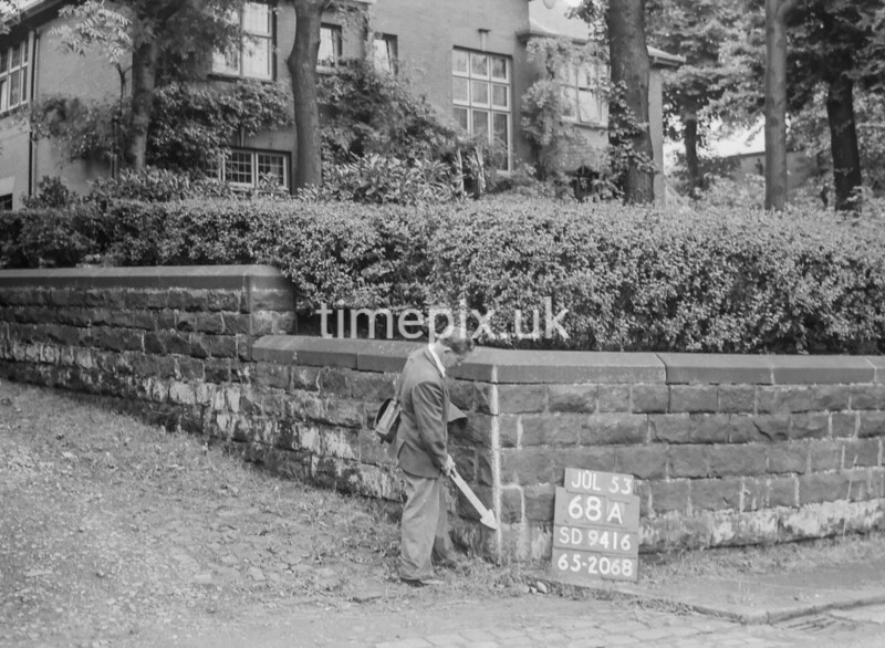 SD941668A, Man marking Ordnance Survey minor control revision point with an arrow in 1950s