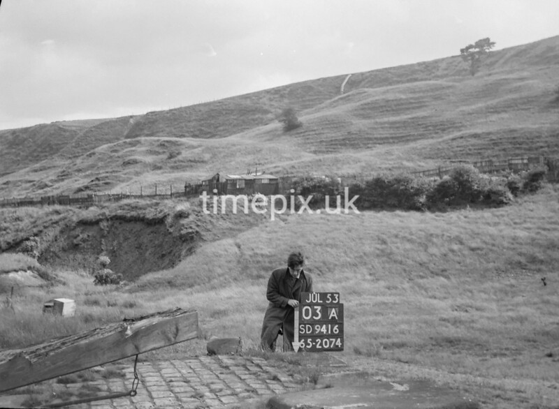 SD941603A, Man marking Ordnance Survey minor control revision point with an arrow in 1950s
