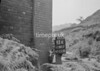 SD941793K, Man marking Ordnance Survey minor control revision point with an arrow in 1950s