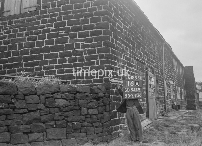 SD941816A, Man marking Ordnance Survey minor control revision point with an arrow in 1950s