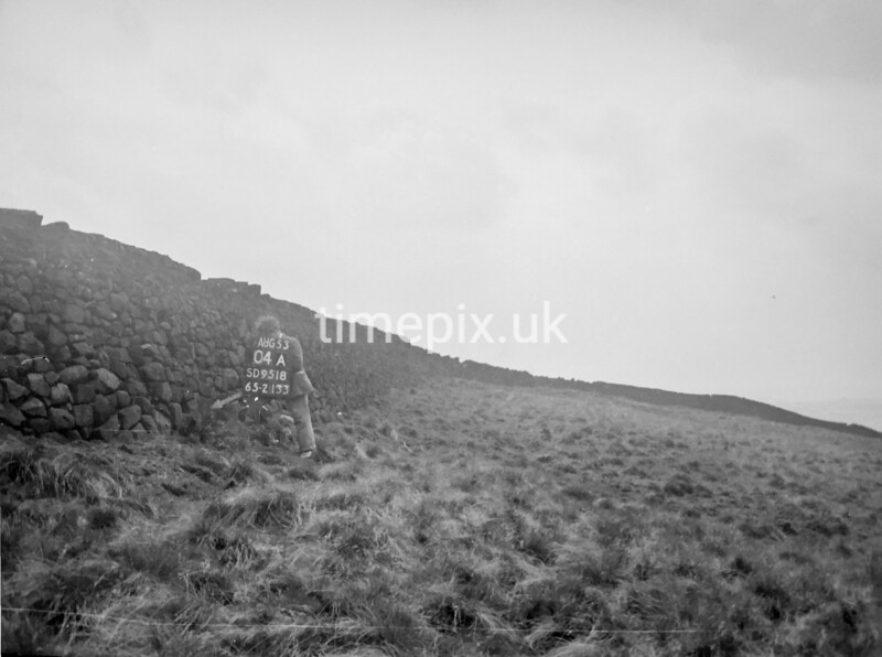 SD951804A, Man marking Ordnance Survey minor control revision point with an arrow in 1950s