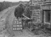 SD941673A, Man marking Ordnance Survey minor control revision point with an arrow in 1950s