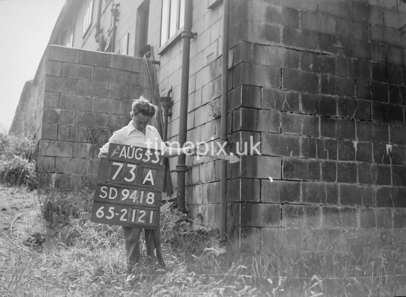 SD941873A, Man marking Ordnance Survey minor control revision point with an arrow in 1950s