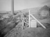SD941820B, Man marking Ordnance Survey minor control revision point with an arrow in 1950s