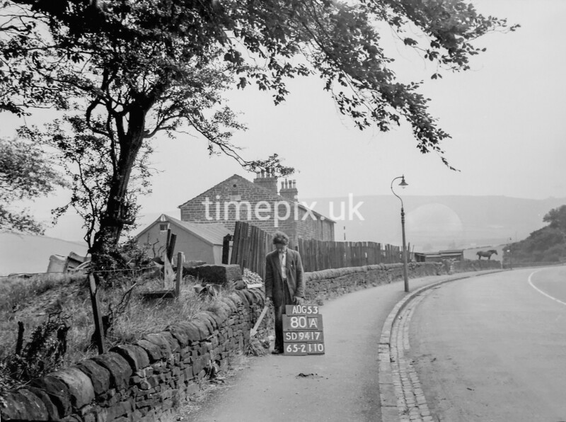 SD941780A, Man marking Ordnance Survey minor control revision point with an arrow in 1950s