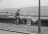 SD941647B, Man marking Ordnance Survey minor control revision point with an arrow in 1950s