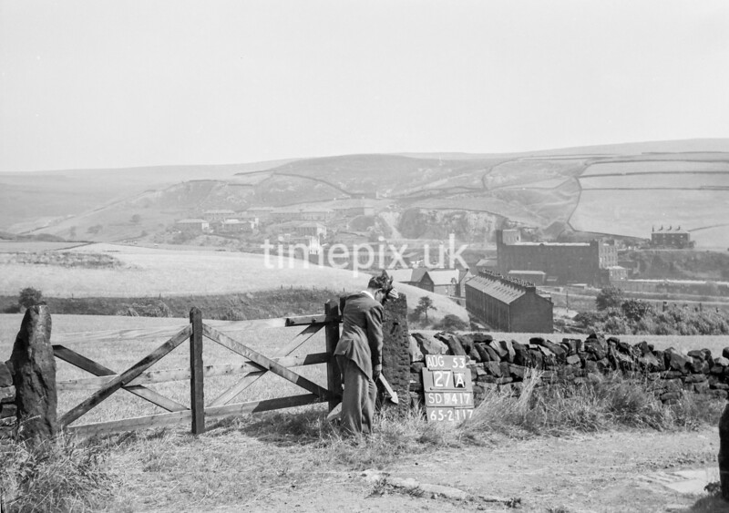 SD941727A, Man marking Ordnance Survey minor control revision point with an arrow in 1950s