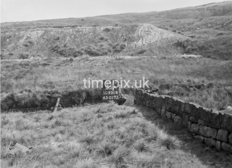 SD951835A, Man marking Ordnance Survey minor control revision point with an arrow in 1950s
