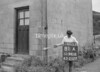 SD941881A, Man marking Ordnance Survey minor control revision point with an arrow in 1950s