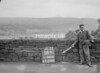 SD941658B, Man marking Ordnance Survey minor control revision point with an arrow in 1950s