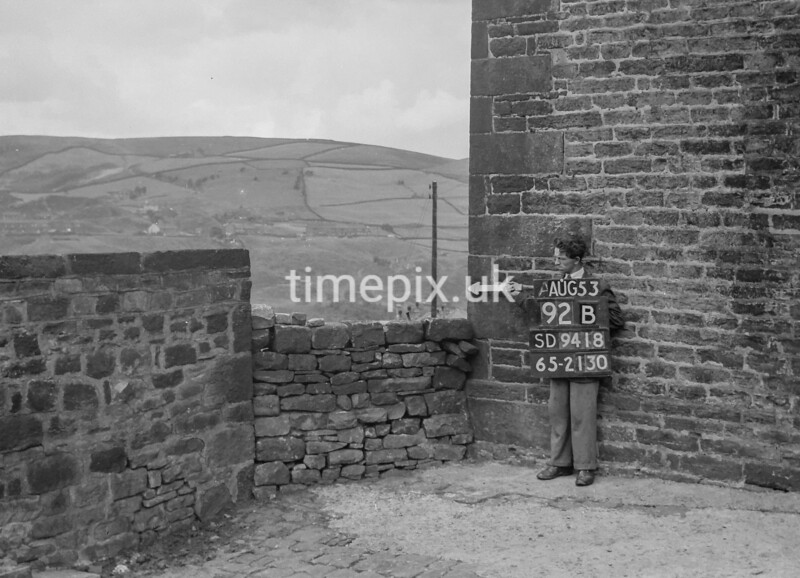 SD941892B, Man marking Ordnance Survey minor control revision point with an arrow in 1950s