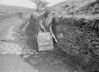 SD941215A, Man marking Ordnance Survey minor control revision point with an arrow in 1950s