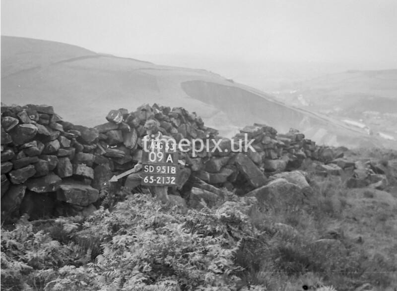 SD951809A, Man marking Ordnance Survey minor control revision point with an arrow in 1950s