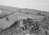 SD941815A, Man marking Ordnance Survey minor control revision point with an arrow in 1950s