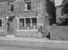 SD941863A, Man marking Ordnance Survey minor control revision point with an arrow in 1950s