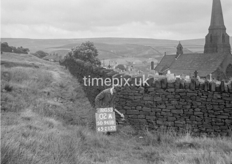 SD941802A, Man marking Ordnance Survey minor control revision point with an arrow in 1950s