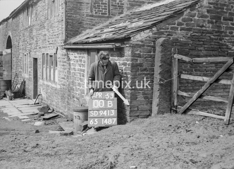 SD941300B, Man marking Ordnance Survey minor control revision point with an arrow in 1950s