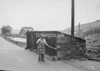 SD941769A, Man marking Ordnance Survey minor control revision point with an arrow in 1950s