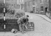 SD941604A, Man marking Ordnance Survey minor control revision point with an arrow in 1950s