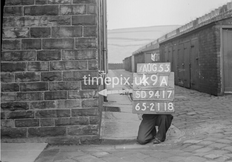 SD941749A, Man marking Ordnance Survey minor control revision point with an arrow in 1950s