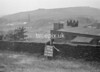 SD941779B, Man marking Ordnance Survey minor control revision point with an arrow in 1950s