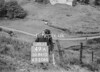 SD941549A, Man marking Ordnance Survey minor control revision point with an arrow in 1950s