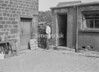 SD941773A, Man marking Ordnance Survey minor control revision point with an arrow in 1950s