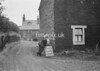 SD941794A, Man marking Ordnance Survey minor control revision point with an arrow in 1950s