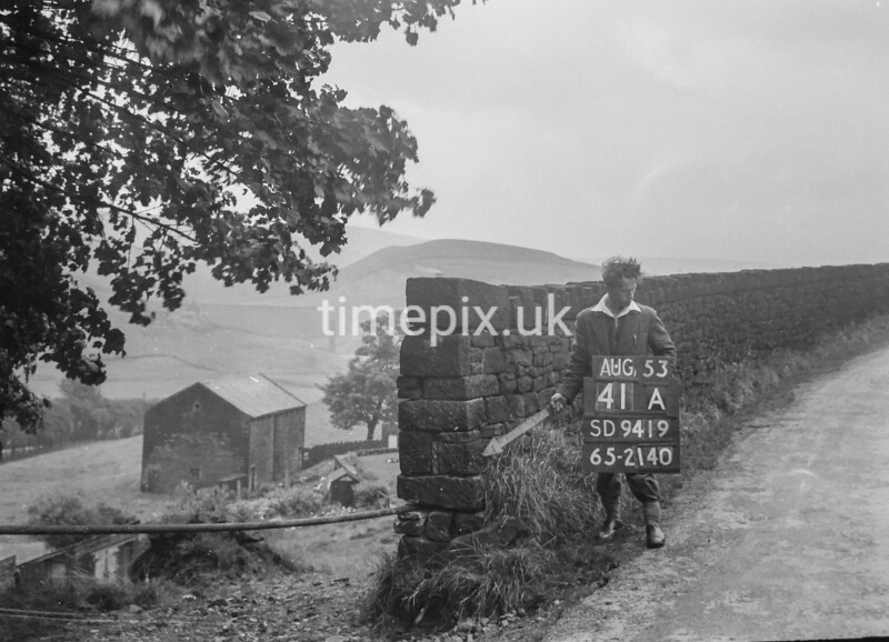 SD941941A, Man marking Ordnance Survey minor control revision point with an arrow in 1950s