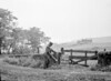 SD941770A, Man marking Ordnance Survey minor control revision point with an arrow in 1950s