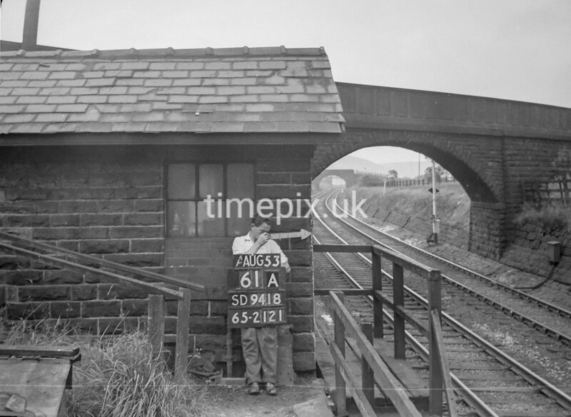 SD941861A, Man marking Ordnance Survey minor control revision point with an arrow in 1950s