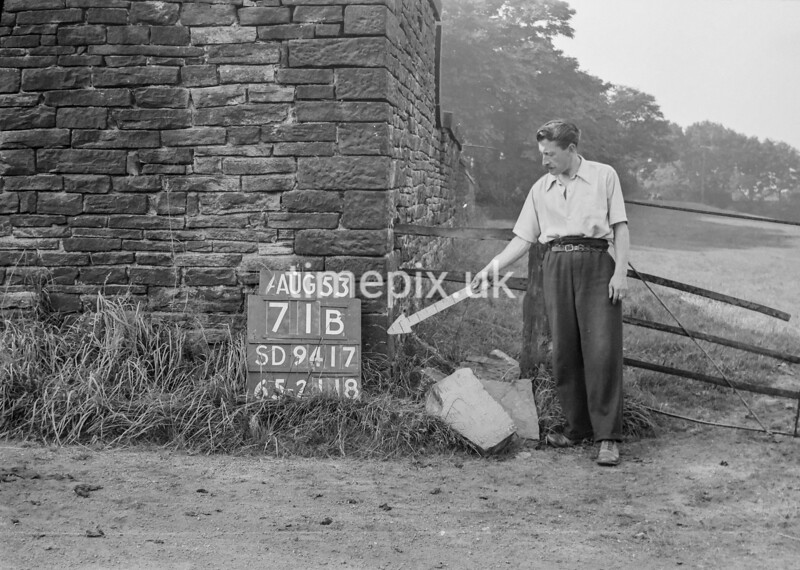 SD941771B, Man marking Ordnance Survey minor control revision point with an arrow in 1950s