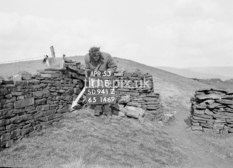 SD941211B, Man marking Ordnance Survey minor control revision point with an arrow in 1950s
