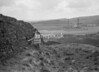 SD941893A, Man marking Ordnance Survey minor control revision point with an arrow in 1950s