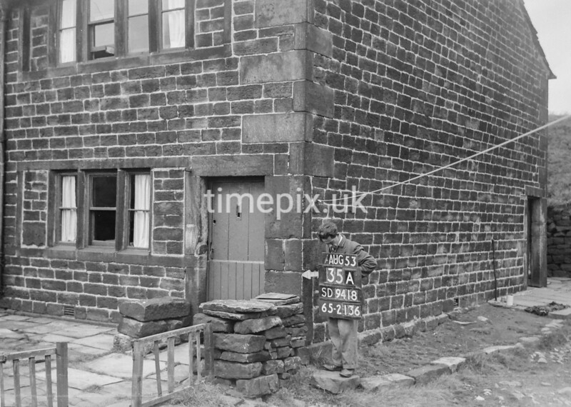 SD941835A, Man marking Ordnance Survey minor control revision point with an arrow in 1950s