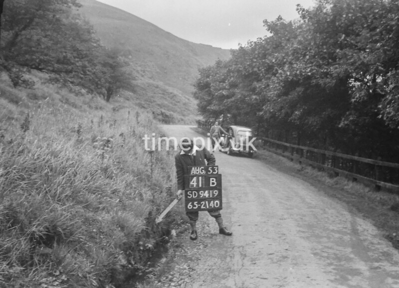 SD941941B, Man marking Ordnance Survey minor control revision point with an arrow in 1950s
