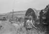 SD941765A, Man marking Ordnance Survey minor control revision point with an arrow in 1950s