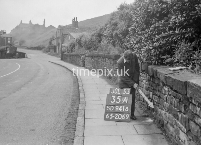 SD941635A, Man marking Ordnance Survey minor control revision point with an arrow in 1950s