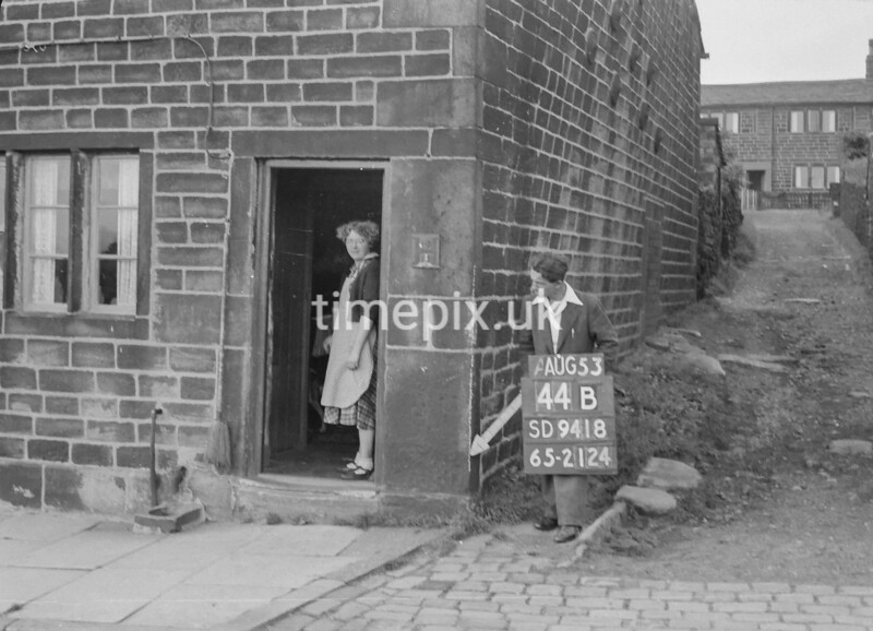 SD941844B, Man marking Ordnance Survey minor control revision point with an arrow in 1950s
