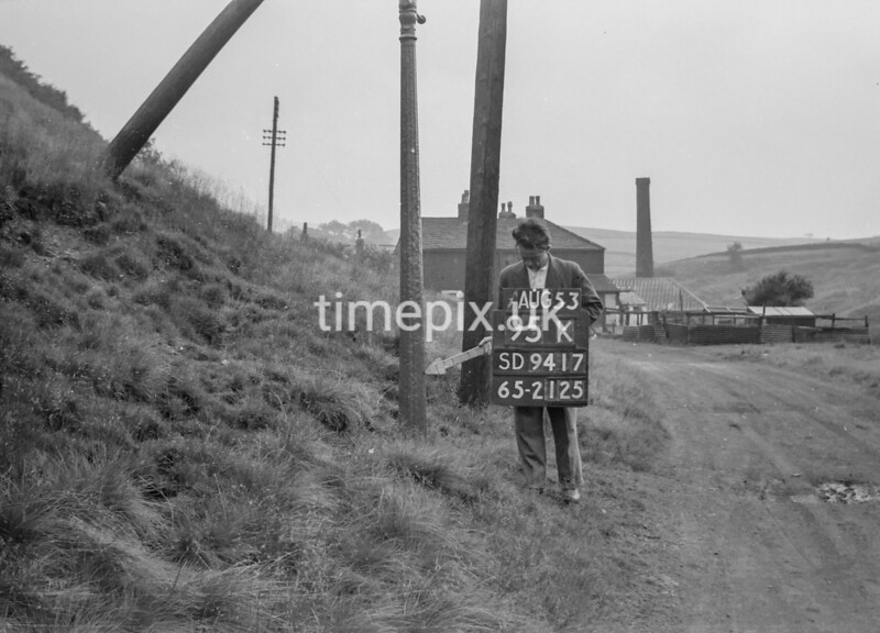 SD941795K, Man marking Ordnance Survey minor control revision point with an arrow in 1950s
