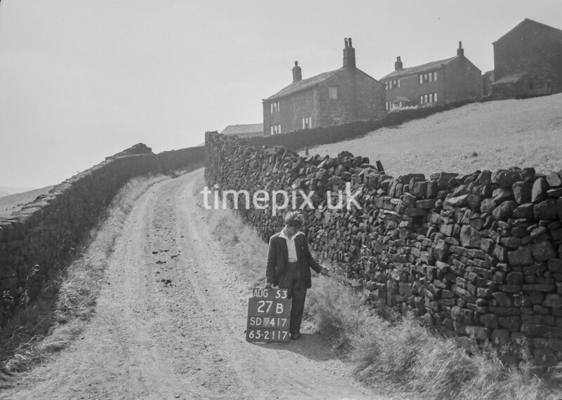 SD941727B, Man marking Ordnance Survey minor control revision point with an arrow in 1950s