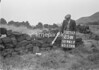 SD941725W, Man marking Ordnance Survey minor control revision point with an arrow in 1950s
