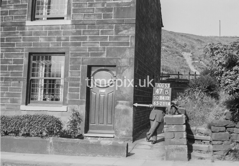 SD941747B, Man marking Ordnance Survey minor control revision point with an arrow in 1950s