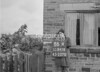 SD941686A, Man marking Ordnance Survey minor control revision point with an arrow in 1950s