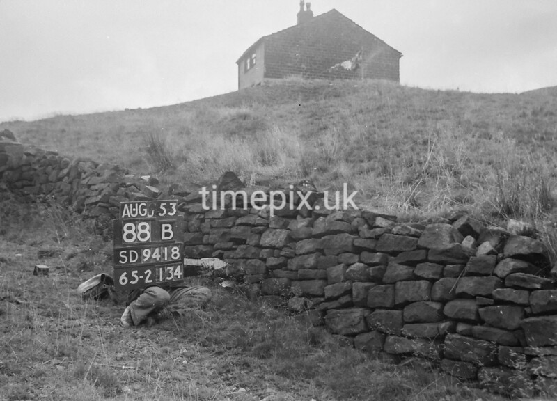 SD941888B, Man marking Ordnance Survey minor control revision point with an arrow in 1950s