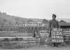 SD941612A, Man marking Ordnance Survey minor control revision point with an arrow in 1950s