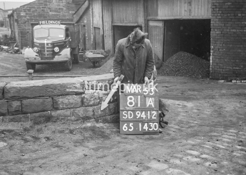 SD941281A, Man marking Ordnance Survey minor control revision point with an arrow in 1950s